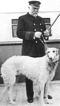 Captain Smith on Titanic's deck with a dog, possibly his own.