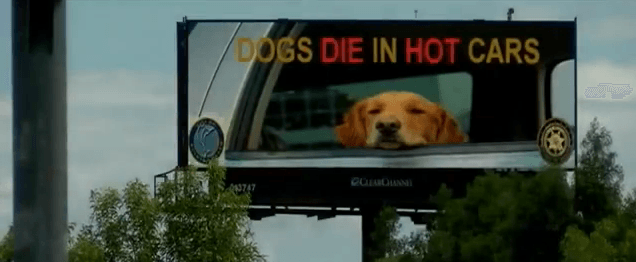 A billboard high above Florida's I-95 reminds people to not leave dogs in hot cars.