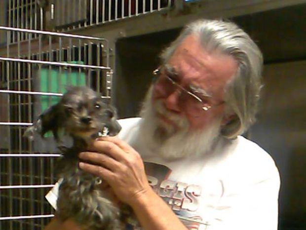 Mike Nuanes' tearful reunion with Jordan, a dog that has been missing for 7 years! Photo via Fulton County Animal Services.