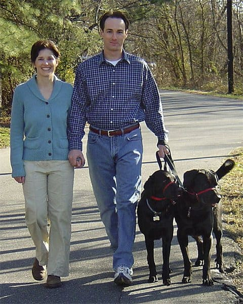 Berwyn Heights, Maryland Mayor Cheye Calvo and his wife Trinity Tomsic walking their Black Labs, Payton and Chase, after executing a SWAT raid at the wrong address.