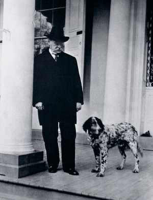 Grover Cleveland on the White House steps along with one of many First Dogs.